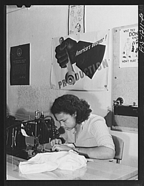 Working on the main seams of pilot parachutes, Pacific Parachute Company. San Diego, California. A double-needle sewing machine is used