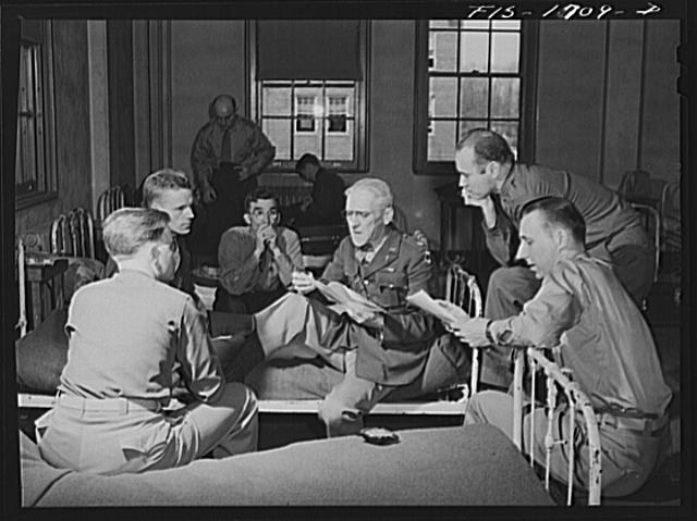 Chaplain (Lieutenant Colonel) Paul B. Rupp discussing problems these newly graduated chaplains will encounter under actual war conditions. U.S Army chaplain school, Fort Benjamin Harrison, Indiana