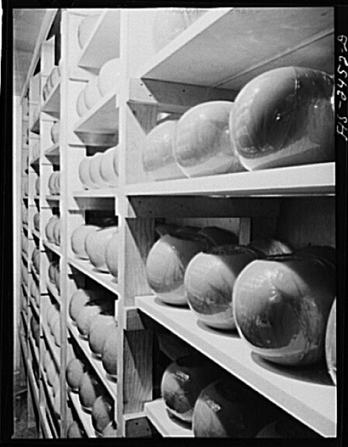 Iowa State College. Ames, Iowa. Edam cheeses made at the school in storage in the dairy industry department