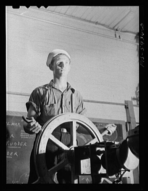 Hoffman Island, merchant marine training center off Staten Island, New York. Trainee at ship's wheel in the class room