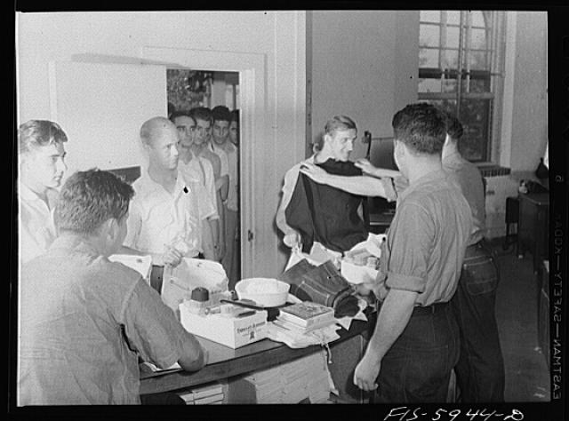 Hoffman Island, merchant marine training center off Staten Island, New York. New arrivals getting clothing and other equipment issued to them the first day