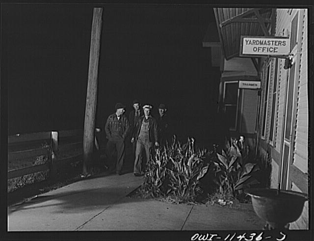 Amarillo, Texas. Railroad employees coming to work on a night shift at the Santa Fe Railroad yards
