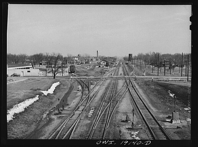 Main line tracks and a town along the tracks of the Atchison, Topeka and Santa Fe Railroad. Marceline, Missouri