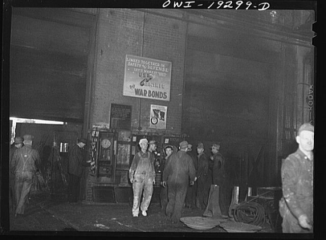 Topeka, Kansas. Workmen checking out for lunch at the Atchison, Topeka and Santa Fe Railroad locomotive shops