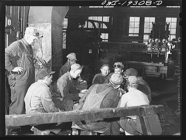 Topeka, Kansas. Workmen in the Atchison, Topeka and Santa Fe Railroad locomotive shops having a game of cards during lunch period
