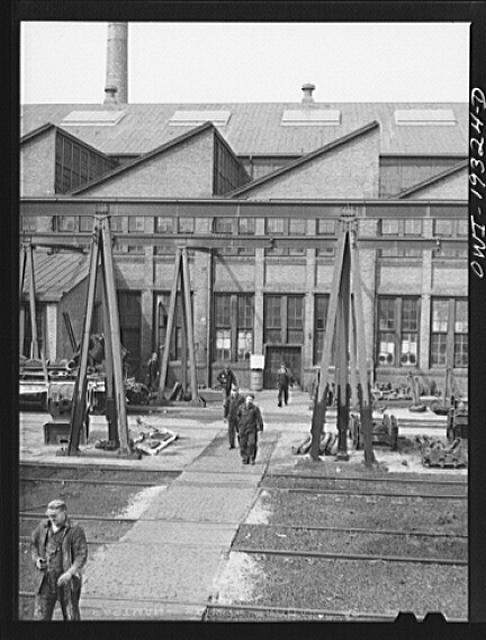 Topeka, Kansas. Workmen coming out of the Atchison, Topeka and Santa Fe Railroad locomotive shops during lunch period