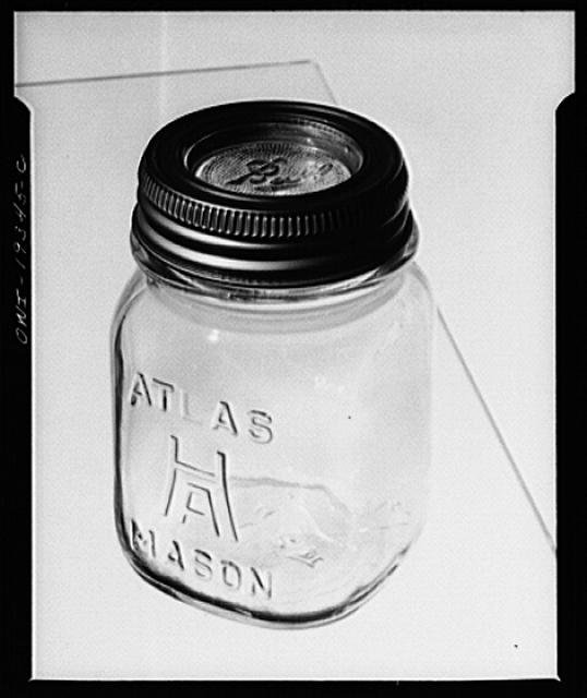 Steel-saving glass-top jars recommended by the War Production Board, Containers Division, for home canning of the Victory garden fruits and vegetables in 1943