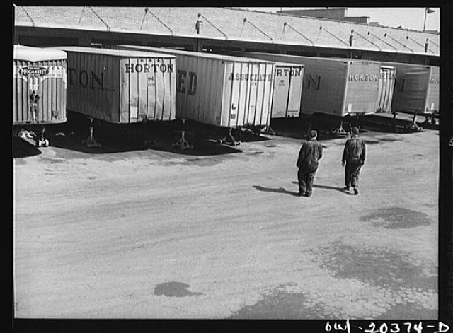 Baltimore, Maryland. Trucks at the loading dock of the Associated Transport Company