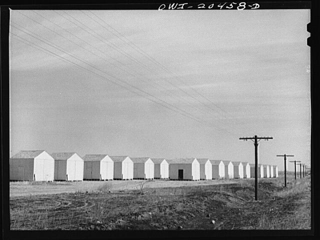 Hereford, Texas. Grain storage bins along the Atchison, Topeka and Santa Fe Railroad