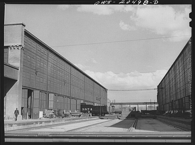 Albuquerque, New Mexico. Tender coming out of the Atchison, Topeka and Santa Fe Railroad locomotive shops on to the transfer table