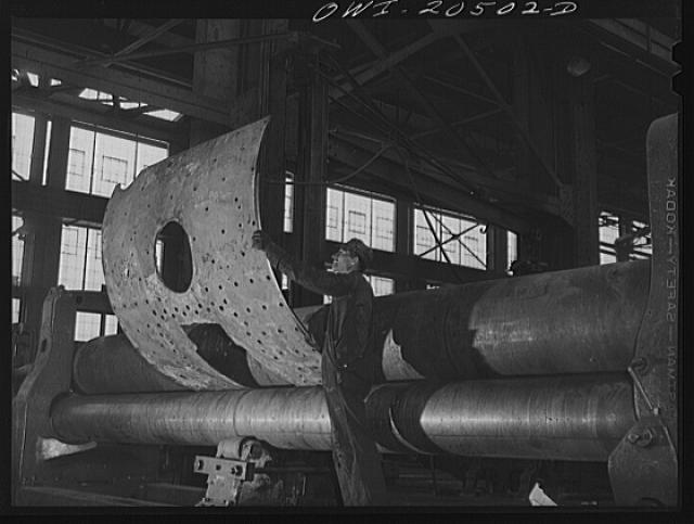 Albuquerque, New Mexico. Rolling a boiler smoke box sheet in the Atchison, Topeka and Santa Fe Railroad locomotive shops