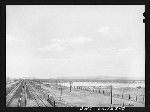 Atchison, Topeka, and Santa Fe Railroad train stopping at a siding enroute to Needles, California
