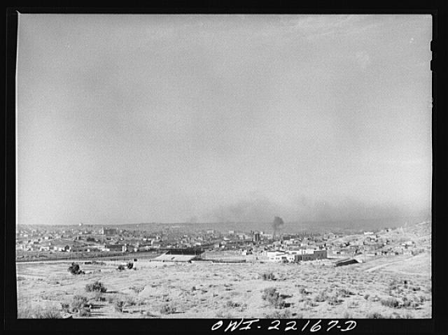 Gallup, New Mexico. General view of the town showing Atchison, Topeka, and Santa Fe Railroad yards and shops
