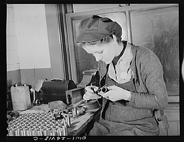 Milwaukee, Wisconsin. War production workers making M5 and M7 guns for the U.S. Army. Ex-housewife, age twenty-four, filing small parts. Her husband and brother are in the armed service