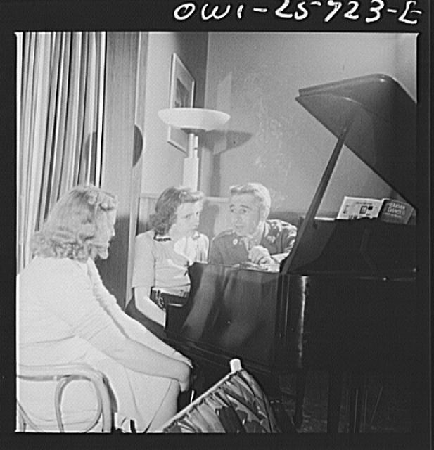Arlington, Virginia. A group around a piano in the main lounge at Idaho Hall, Arlington Farms, a residence for women who work in the government for the duration of the war