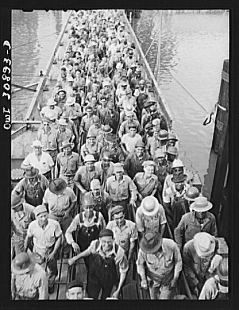 Beaumont, Texas. Shipyard workers leaving the Pennsylvania shipyards at the change of shift