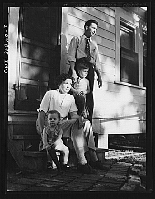 Beaumont, Texas. Mrs. Elsie McMullen, a laundry truck driver, with her family