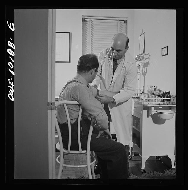 New York, New York. A Czech physician, Dr. Winn [or Wynn], treating a patient in his office