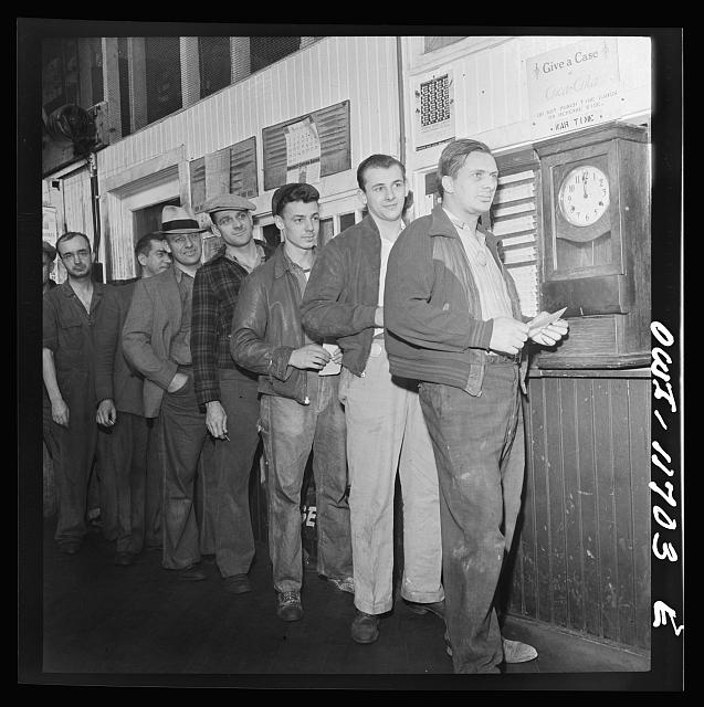 Lititz, Pennsylvania. Employees in the Animal Trap Company machine shop checking out for lunch