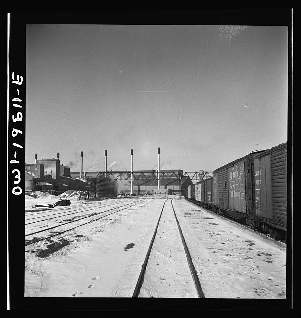 Streator, Illinois. Going through the Atchison, Topeka and Santa Fe Railroad yard. In the background is a large bottling works