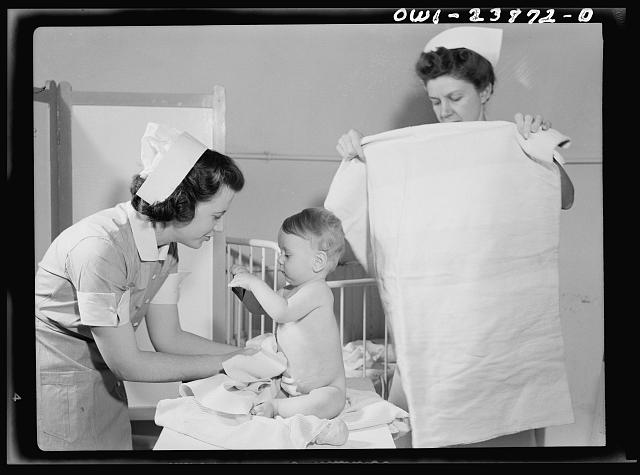 A convalescing youngster is dried after his bath by student nurse Frances Bullock, (left). Experience in the pediatric and obstetrical wards is included in every student nurse's training