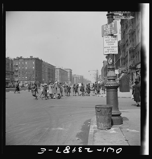 New York, New York. Many accidents are attributed to unpatrolled intersections in Harlem. Here school children are allowed to run across busy intersections unescorted