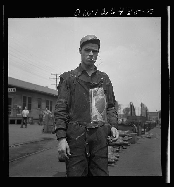 Bethlehem-Fairfield shipyards, Baltimore, Maryland. Worker with a personal monogram on his overalls