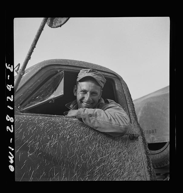 Private Zeno W. Muhl, of Baltimore, Maryland serving with the 429th Engineers as a truck driver. He is a trucker in civilian life, owning his own dump truck