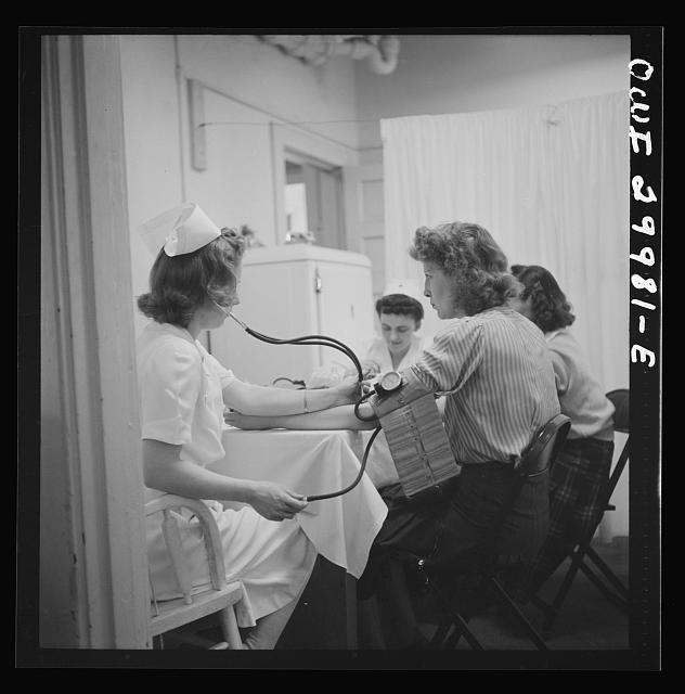 Washington, D.C. Routine health examinations are given to all volunteer blood donors at the American Red Cross center