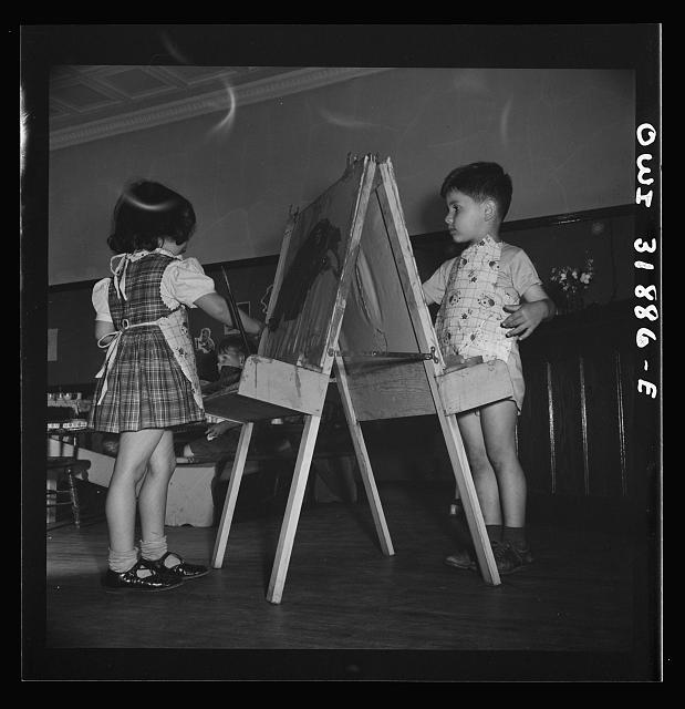 New Britain, Connecticut. A child care center, opened September 15, 1942, for thirty children, age two to five, of mothers engaged in war industry. The hours are 6:30 a.m. to 6 p.m. six days per week. Children painting and coloring
