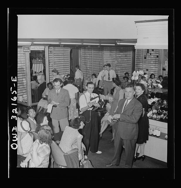Washington, D.C. A busy shoe store on the last day on which war ration shoe coupon seventeen may be used