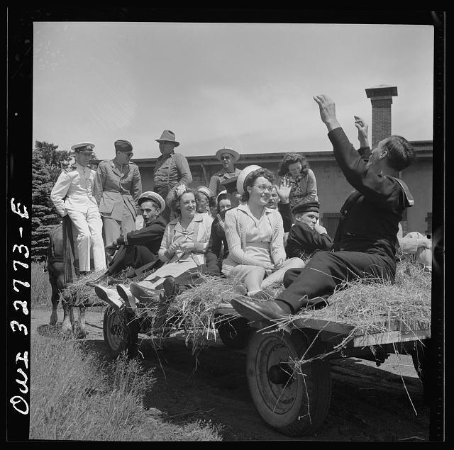 Oswego, New York. Belgian sailor leads singing on a hayride for the United Nations heroes and Oswego girls during United Nations week