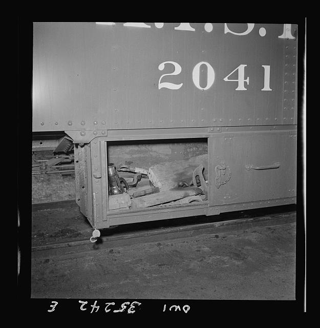 Clovis, New Mexico. Compartment in a new Atchison, Topeka and Santa Fe Railroad caboose containing a jack and other tools for making flight running repairs