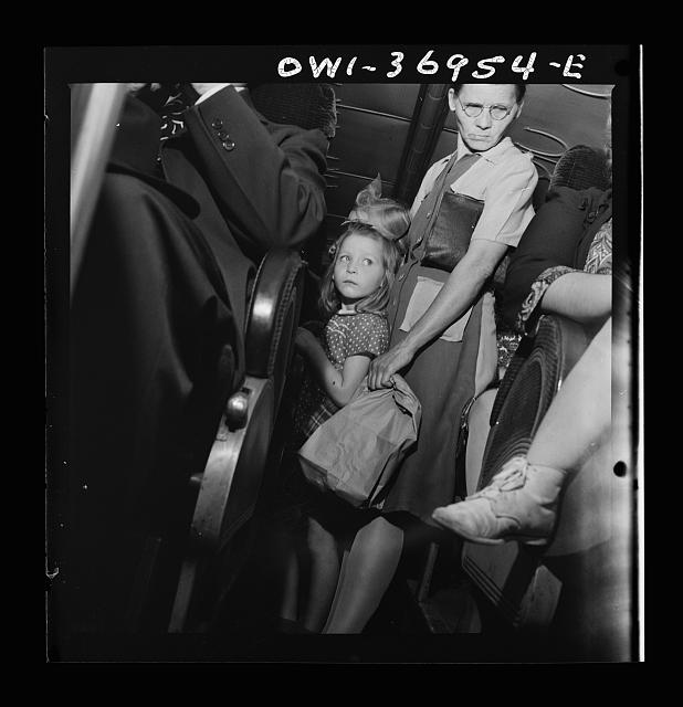 Passengers standing in the aisle of a Greyhound bus going from Washington, D.C. to Pittsburgh, Pennsylvania