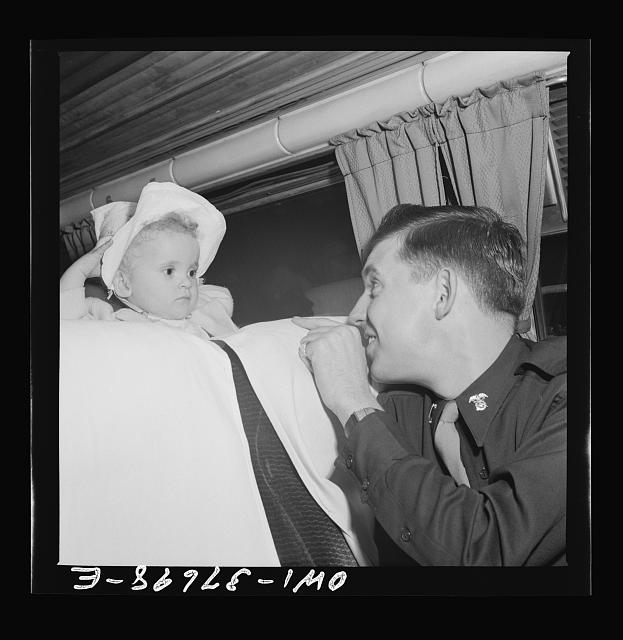 A lieutenant getting acquainted with one of the passengers on a Greyhound bus enroute from Cincinnati, Ohio to Louisville, Kentucky. He makes this trip almost every weekend to visit relatives