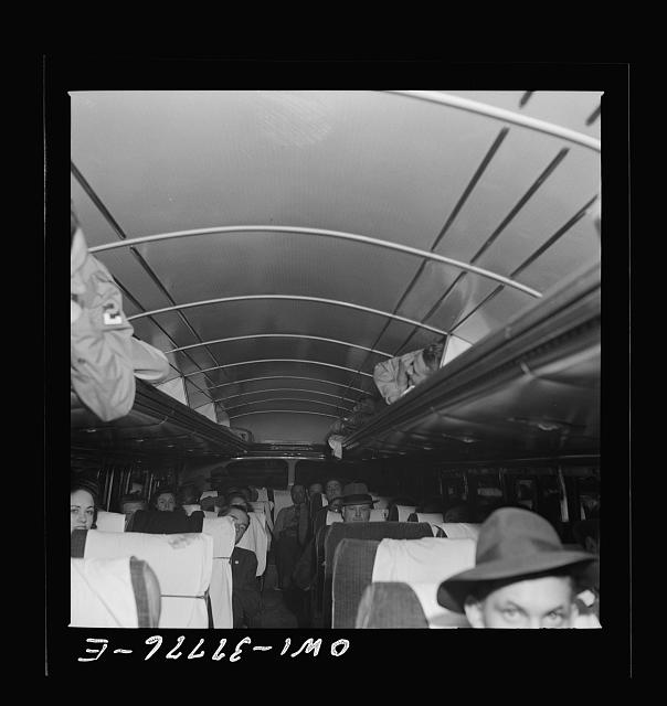 Bus passengers on their way from Cincinnati, Ohio to Louisville, Kentucky on a Greyhound bus