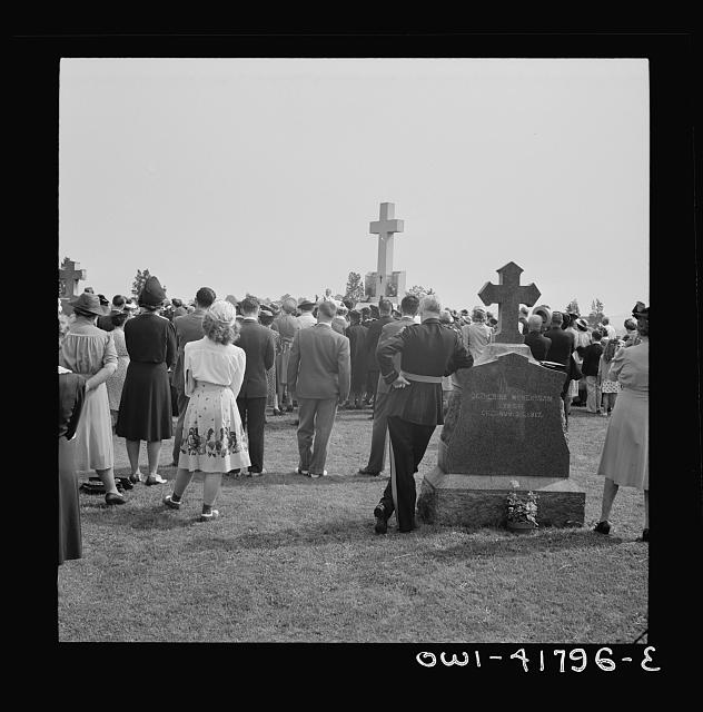 Southington, Connecticut. On All Soul's Day the Catholic congregation is gathering in the Saint Thomas cemetery for an outdoor Mass which in 1942 was officiated by the Reverend Francis J. Mihalek