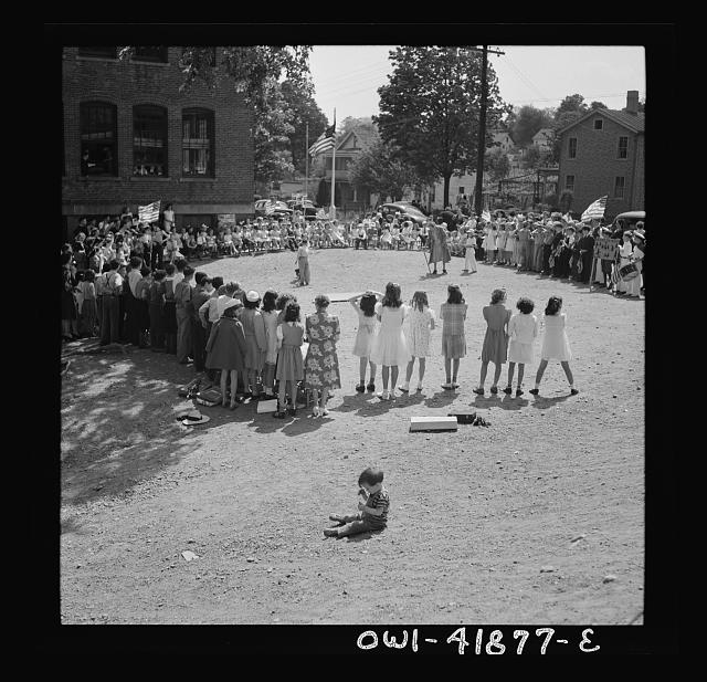 Southington, Connecticut. Young people watching a game
