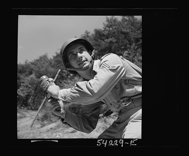 Fort Belvoir, Virginia. A soldier learning to throw a hand grenade