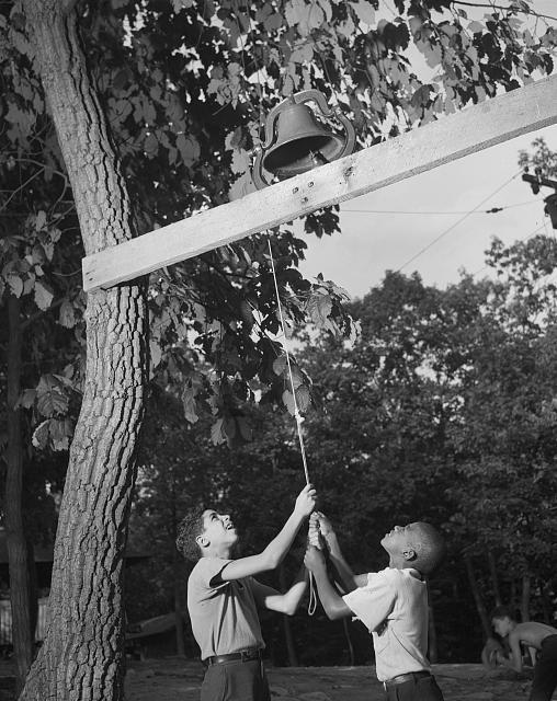 Southfields, New York. Interracial activities at Camp Nathan Hale, where children are aided by the Methodist Camp Service. Dinner bell
