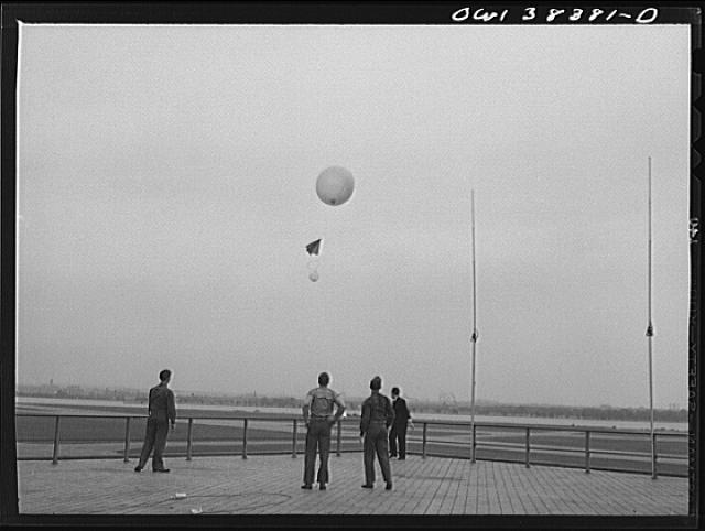 Washington, D.C. The U.S. Weather Bureau station at the National Airport. Atmospheric conditions are transmitted by a weather radio instrument attached to the balloon which ascends to heights of fifteen to twenty miles