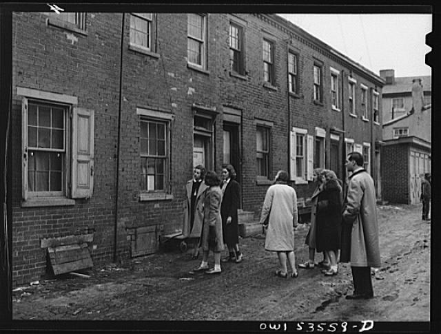 Wilmington, Delaware. Tower Hill School, noted country day school for pupils from three to eighteen years of age. Some of the high school pupils of a social science class apparently studying alley dwellings