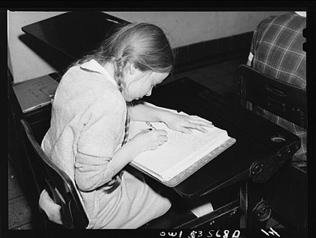 Wilmington, Delaware. Tower Hill School, noted country day school for pupils from three to eighteen years of age. A young pupil writing in a notebook at her desk