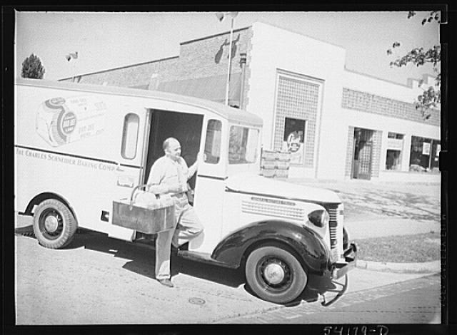 Washington, D.C. A Charles Schneider Baking Company delivery truck displaying a United States Truck Conservation Corps pledge, showing a driver alighting with a basket of bread