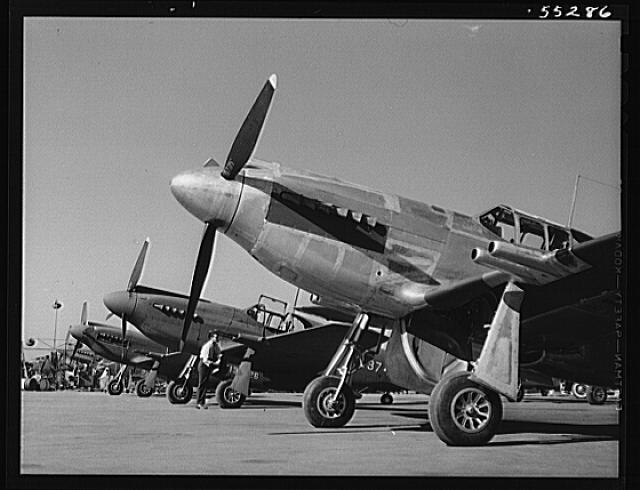 North American P-51 fighters await flight tests on the flight ramp. The P-51 is the Army Air Force's newest fighter
