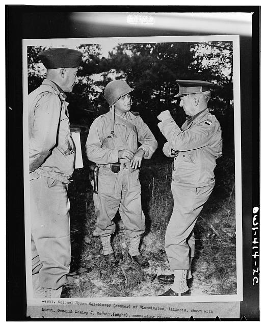 Lieutenant Colonel Byron Coleblazer (center) of Bloomington, Illinois, shown with Lieutenant General Lesley J. McNair (right), commanding general of the U.S. Army ground forces, discussing one of the problems worked out during the recent maneuvers of the Third Army in Louisiana. Colonel Coleblazer is the executive officer