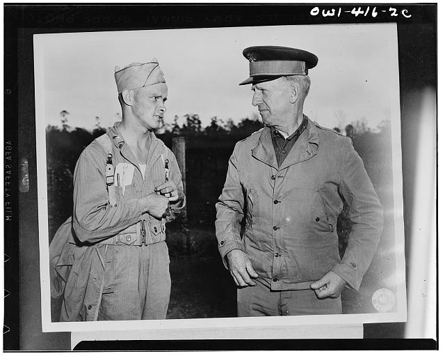 Lieutenant General Lesley J. McNair, right, commanding general of the U.S. Army ground forces, discussing with an umpire one of the problems being worked out at the recent maneuvers of the Third Army in Louisiana