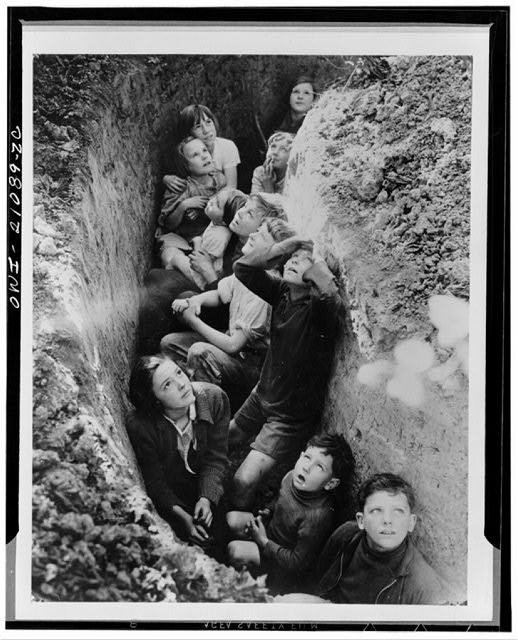 Children in an English bomb shelter. British Information Service