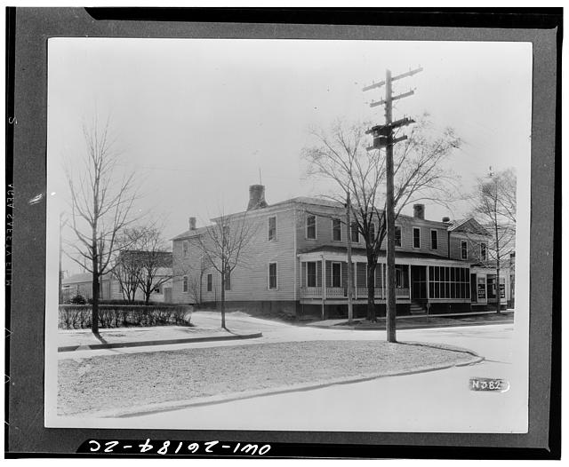 Williamsburg, Virginia. The capitol of the Virginia colony during the eighteenth century which was reconstructed and restored to its original state by John D. Rockefeller Jr. during the 1930s. The Market Square Tavern before restoration