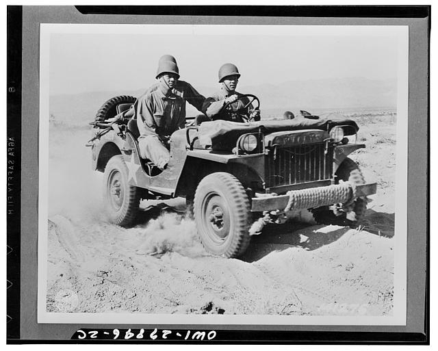 Indio, California. A half-ton jeep rolling over the desert at the desert training center